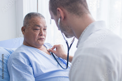 Healthcare and checking pressure, doctor use stethoscope for measurement of old Fototapeta