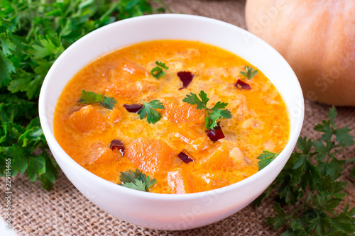 Fotografie, Obraz  Pumpkin curry with pumpkin slices on a plate