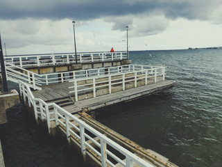 Wooden pier on cloudy day