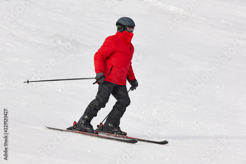 Adult skiing on a snowy hill landscape. Winter sport.