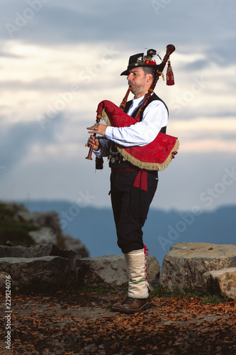 Photo Bergamo Bagpipe. Player with traditional costume