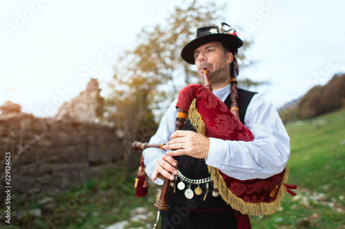 Typical player in traditional bergamo bagpipe from the alpine valleys of norther Canvas Print