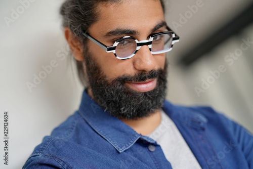 Fotografia, Obraz  Portrait of bearded dark-haired man with blue shirt