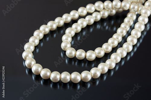 pearls necklace on black background