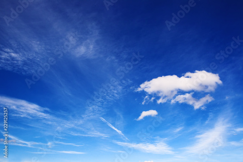 Cloudscape with different types and heights of cloud plus contrail Wallpaper Mural