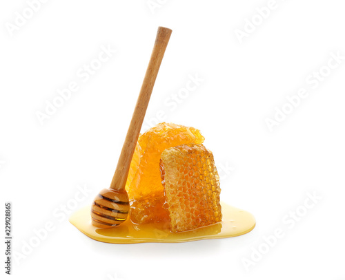 Fresh honeycomb with dipper on white background Poster Mural XXL
