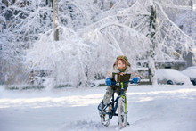 Happy Young Guy Riding Bike On Fresh Snow