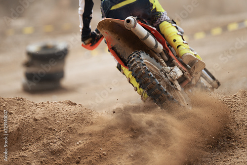 Rider driving in the motocross race the rear wheel motocross bike