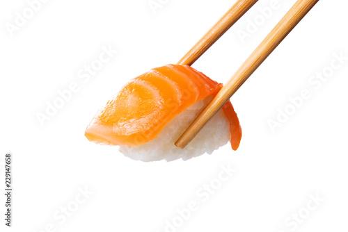 Salmon sushi nigiri in chopsticks