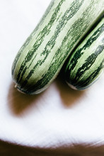 Two Fresh Picked Zucchini's From A Local Orchard In Southern Italy.