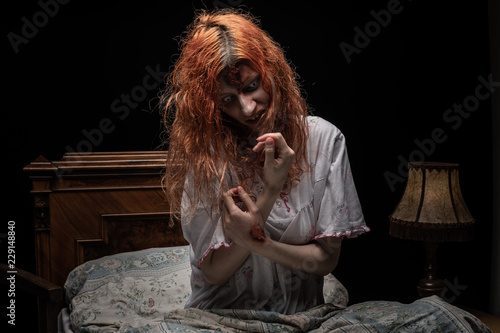 Fotografie, Tablou Scary woman possessed by devil in the bed. Exorcism of priest.