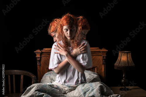 Scary woman possessed by devil in the bed Canvas Print