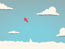 Kite Flying High In The Sky Above The Clouds. Symbol Of Freedom, Childhood, Playful Times.