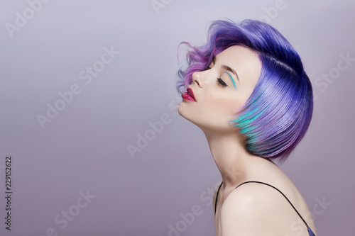 portrait-of-a-woman-with-bright-colored-flying-hair-all-shades-of-purple-hair-coloring-beautiful-lips-and-makeup-hair-fluttering-in-the-wind-sexy-girl-with-short-hair-professional-coloring