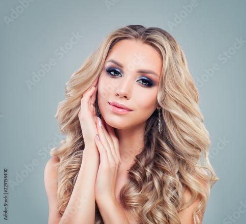 Beautiful Blonde Woman Fashion Model With Long Curly Hair And Makeup On Banner Background With Copy Space Buy This Stock Photo And Explore Similar Images At Adobe Stock Adobe Stock