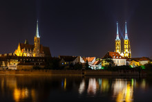 Night View Of Church Of The Holy Cross And St Bartholomew And Cathedral Of Saint John The Baptist In Wroclaw, Poland