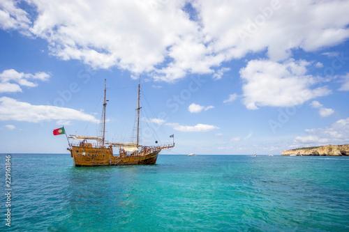 Fototapeta Pirates boat for tourists sailing along Algarvian shore, Portugal