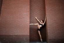 Elegant Ballerina Dancing Ballet In The Streets. Street Ballet