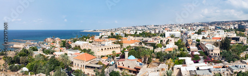 Fotografering Byblos Lebanon - Panoramic view of the historic old buildings along the harbor