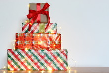 Big Pile Of Colorful Wrapped Gift Boxes Isolated On Wood Table And White Background. Mountain Gifts. Beautiful Present Box With Overwhelming Bow. Christmas Surprise Icon. Happy New Year Decor. Beautif