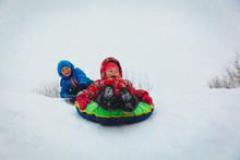 Little Boy And Girl Slide In W...