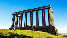 Calton Hill On A Bright Autumn Day.  Tourists On The National Monument.