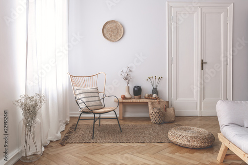 Fototapeta Sheer white curtains on the window of a white living room interior with a stripe