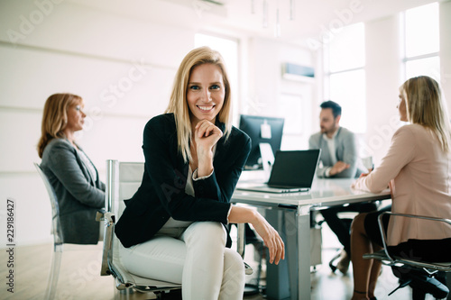 Fototapeta Picture of attractive sales workers on meeting in office obraz