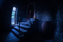 Inside Of Old Creepy Abandoned Mansion. Staircase And Colonnade. Halloween Pumpkin On Dark Castle Stairs To The Basement.