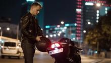 Man Walking Motorcycle Putting On Helmet Gloves Getting On Bike Night City Traffic Street Blur Cinematic