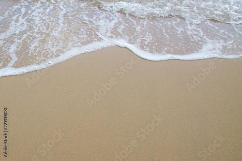 Keuken foto achterwand Strand Soft wave of sea on the sand beach
