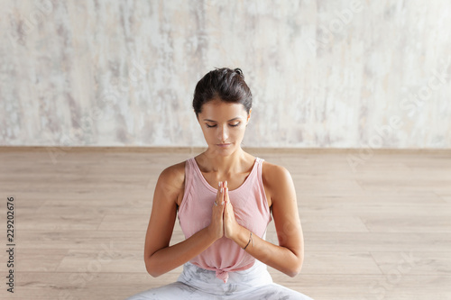 Young girl meditates sitting in the lotus position