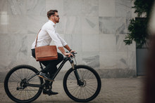 Man Commuting To Office On Bicycle