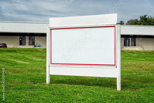 Valokuva  Large Blank White Sign In Commercial Location
