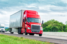 Red Eighteen Wheeler Travels Interstate Highway