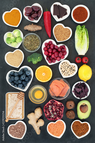 Fototapety, obrazy: Healthy food to slow the ageing process concept including fruit, vegetables, fish, seeds, spice, dairy, honey and pollen grain. Very high in antioxidants, anthocyanins, dietary fibre and vitamins.