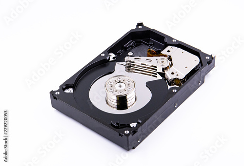 Fotografia  hard drive with the lid open on a white background