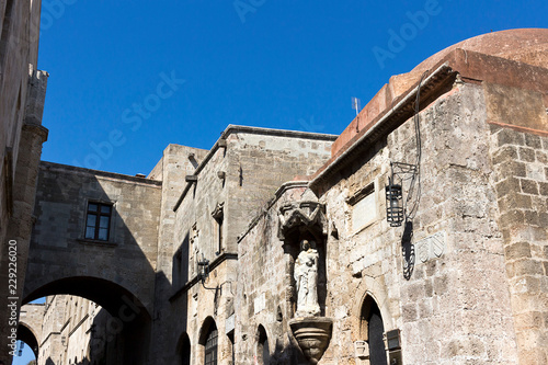 Rhodes Old City - Street of the Knights, statue of Virgin and Child, facade of the Langue of France, Greece