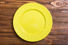 Empty Yellow Plate On Wooden T...
