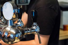 Chrome Beer Taps In Modern Bar Close