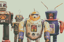 Four Vintage Rusted Colorful Tin Toy Robots