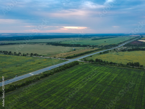 Deurstickers Luchtfoto asphalt road in the field from a height