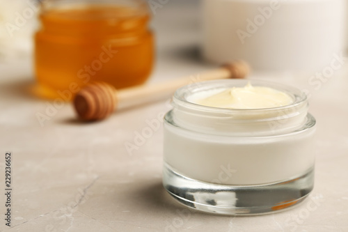 Fototapeta  Closeup view of hand cream jar on gray background