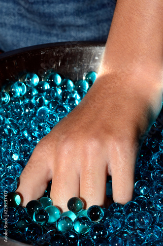 Photo  Water hydrogel pearls and hand