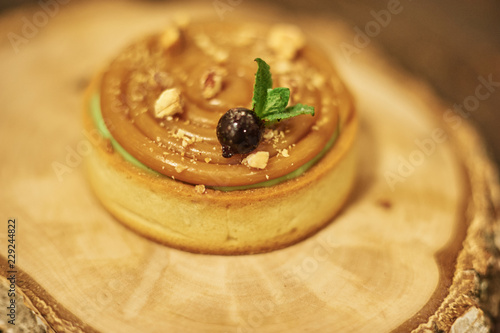 Foto op Canvas Dessert Process of making tart with salted caramel french dessert. Food industry, mass or volume production.
