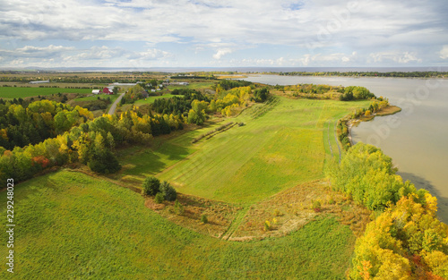 Deurstickers Luchtfoto Autumn aerial view of farmland and lake
