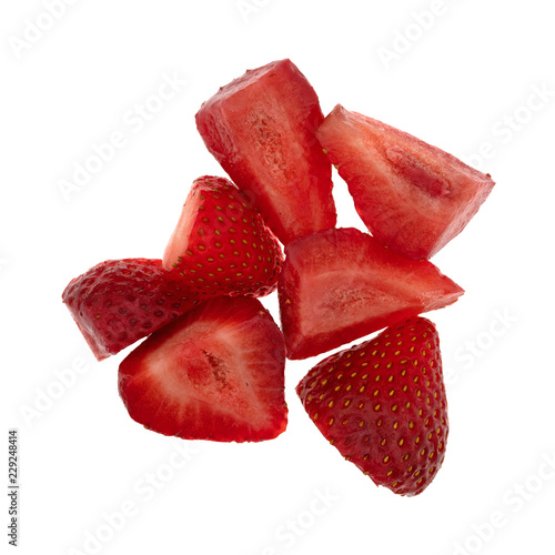 Top view of cut fresh strawberries isolated on a white background.