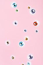 Many Eyes On Pink Background