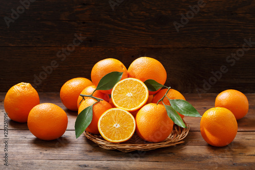 fresh orange fruits on wooden table