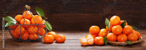 Fresh mandarin oranges fruit or tangerines on wooden table